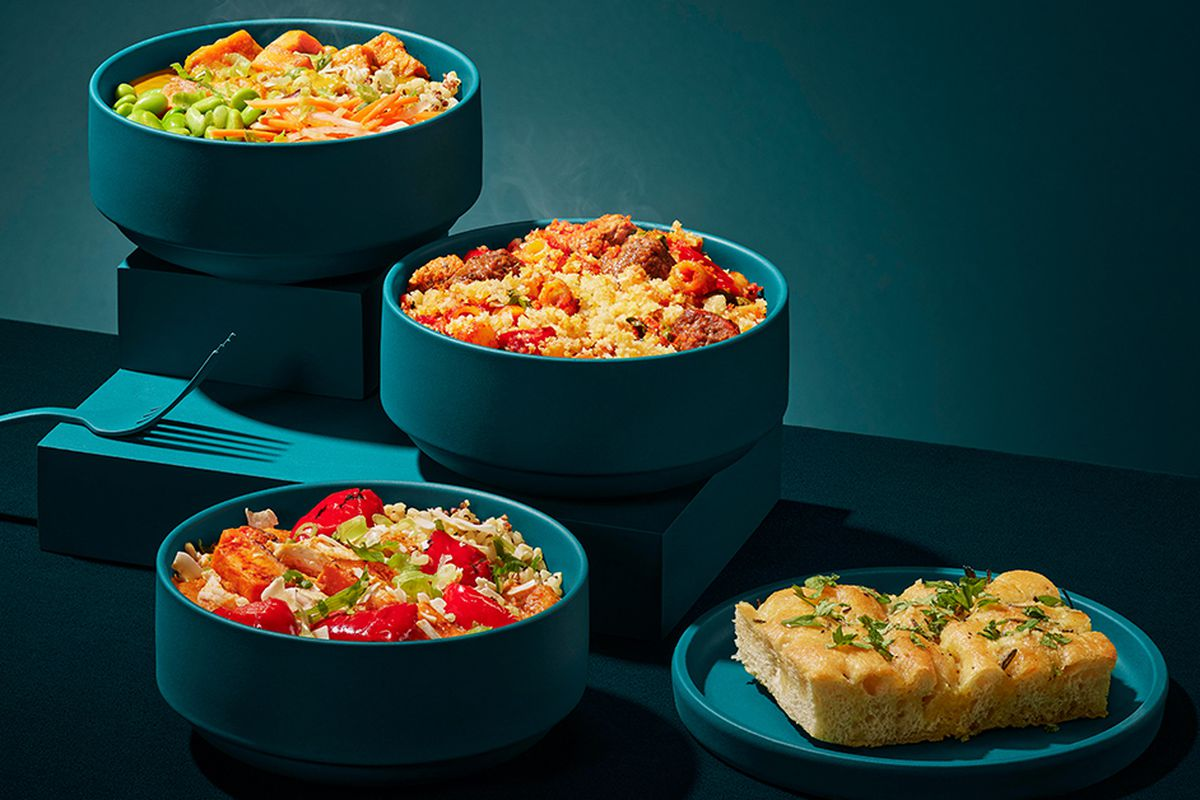 A selection of dishes from the new Pret a Manger dinner menu, in some blue serviceware
