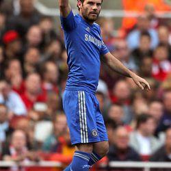Chelsea's Juan Mata celebrates scoring against Arsenal during the English Premier League soccer match at the Emirates Stadium, London, Saturday Sept. 29, 2012. Chelsea won the match 1-2.