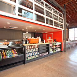 The coffee and food bar area closes with a fully-operable garage door