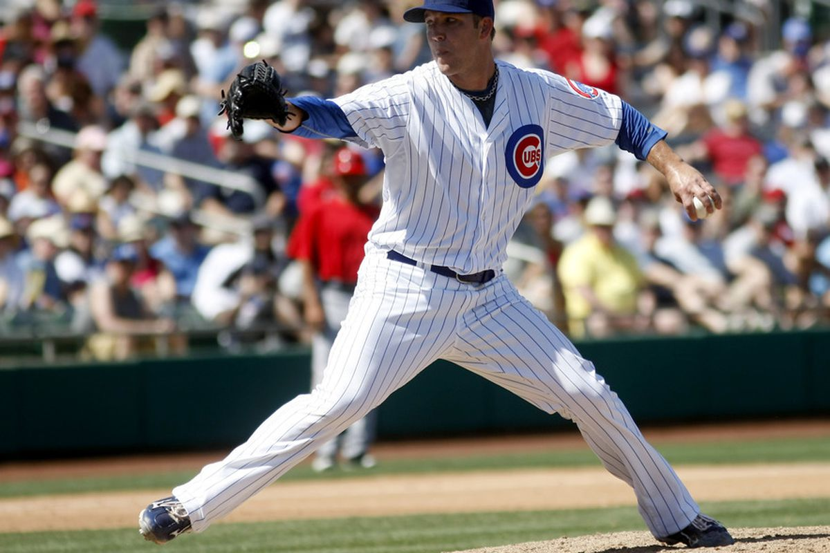 March 31, 2012; Mesa, AZ, USA; Chicago Cubs starting pitcher Paul Maholm (28) throws against the Los Angeles Angels in the third inning at HoHoKam Stadium.  Mandatory Credit: Rick Scuteri-US PRESSWIRE