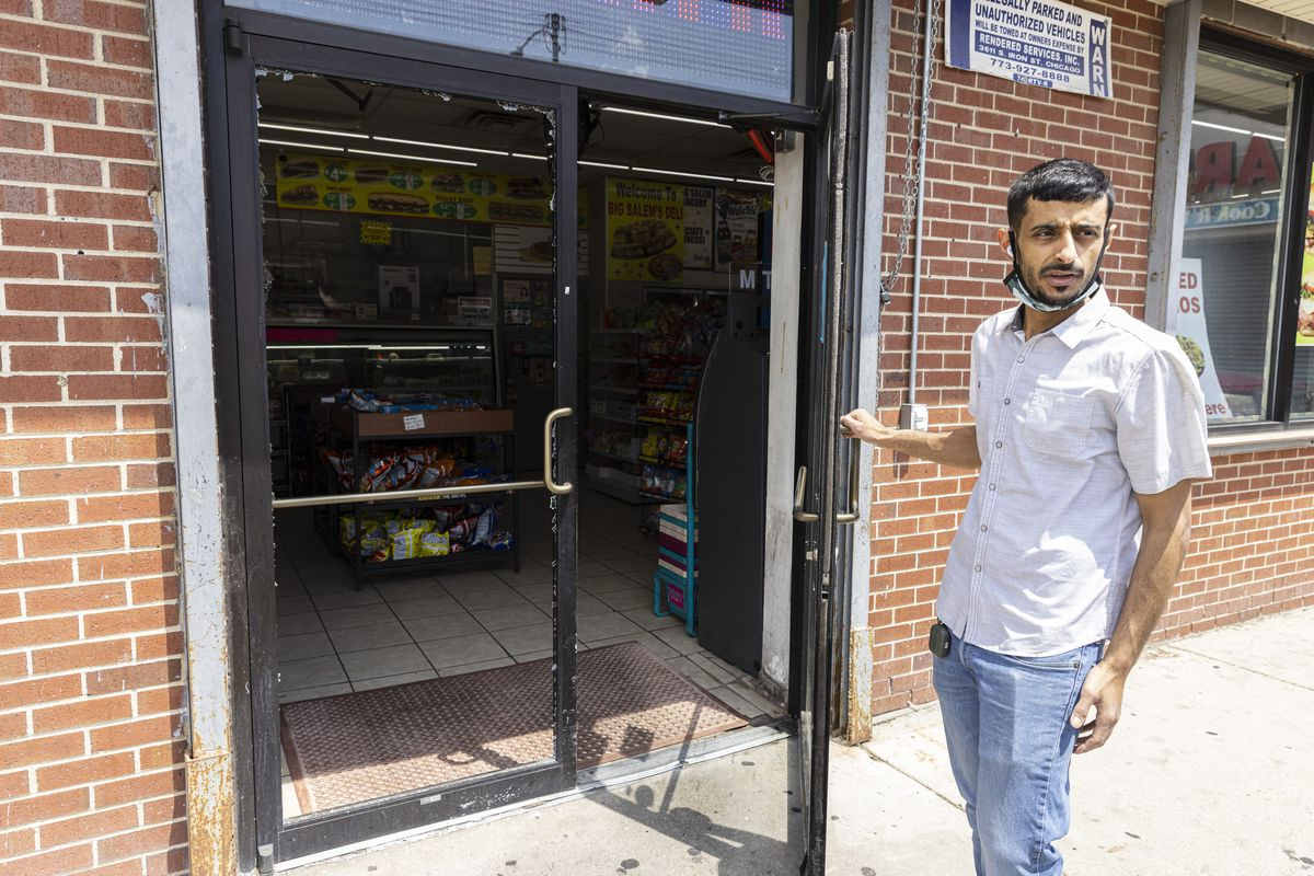 Big Salem's Food Mart Owner, Maged Salem, holds open the door as he recounts stories of William Crawl, an innocent bystander who was shot outside of Big Salem's Food Mart at 1724 E. 71st St. in Southshore, Thursday, May 20, 2021. | Anthony Vazquez/Sun-Times
