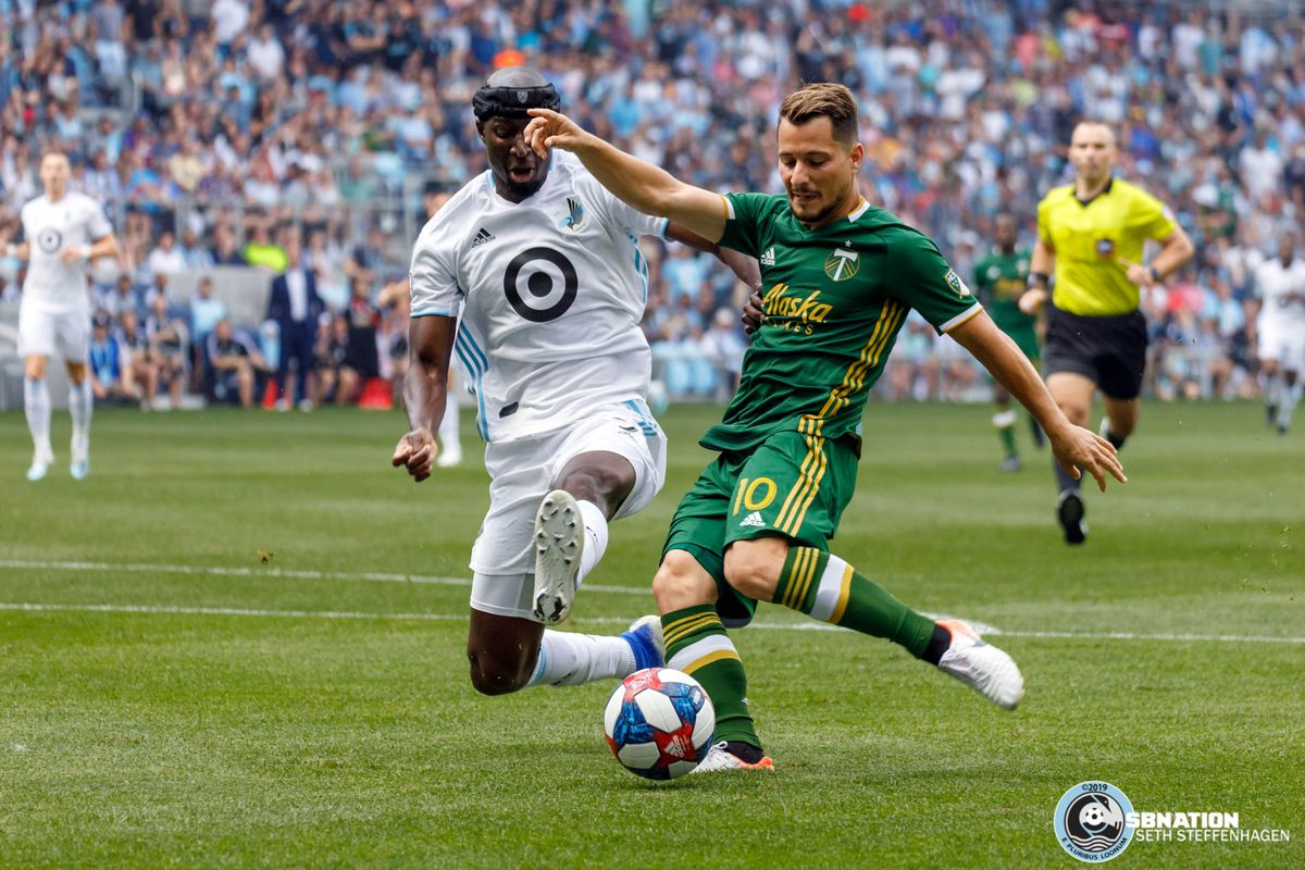 August 4, 2019 - Saint Paul, Minnesota, United States - Minnesota United defender Ike Opara (3) stretches out to block a shot by Portland Timbers midfielder Sebastián Blanco (10) during the match at Allianz Field.