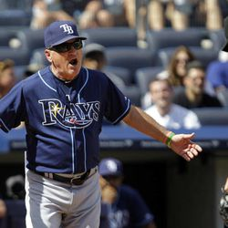 Tampa Bay Rays manager Joe Maddon, left, protests to home plate umpire Paul Emmel after Emmel tossed him from the game in the third inning of a baseball game against the New York Yankees at Yankee Stadium in New  York, Sunday, Sept. 16, 2012.