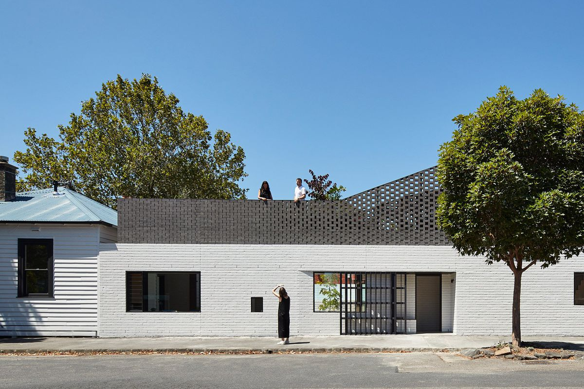 The Brick Extension Was Added To A Small White Victorian Cottage Photos By Peter Bennetts Via Dezeen