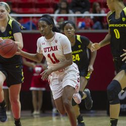 Utah Utes guard Erika Bean (11) takes the ball down the court during the Utes' 84-68 loss to the Oregon Ducks at the Jon M. Huntsman Center in Salt Lake City on Sunday, Jan. 28, 2018.