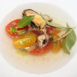 """Tomato water with mussels, celery, and basil from Paul Qui's Dinner at City Grit by <a href=""""http://www.flickr.com/photos/37619222@N04/7697181102/in/pool-29939462@N00/"""">The Food Doc</a>"""