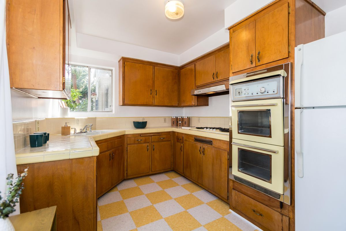 Kitchen with yellow and white checkered floor