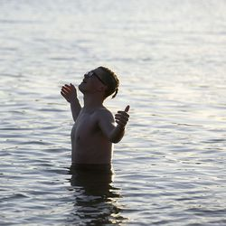 Landon Pearce, a visually impaired 10th grader, takes a polar plunge as the sun rises at Lone Rock Beach at Lake Powell on Saturday, March 27, 2021. He is part of the Utah School for the Deaf and the Blind Yacht Club, which is training for the SEVENTY48, a 70-mile human-powered boat race from Tacoma to Port Townsend, Wash. Members of the school's Yacht Club built their boat for the race by hand.