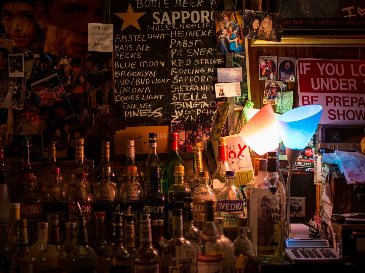 A bar's backboard with a Sapporo-branded beer list