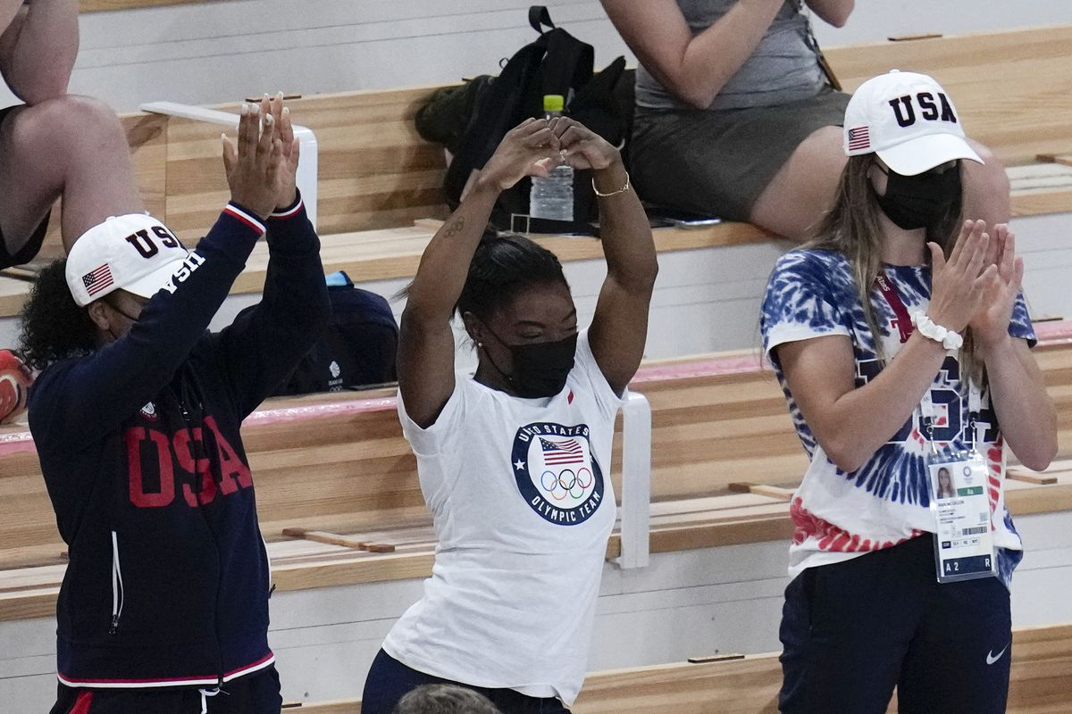Simone Biles of the United States, center, celebrates after teammate Mykayla Skinner won the silver medal in the vault at the Tokyo Olympics.