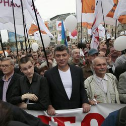 """Opposition leaders Boris Nemtsov, center, and Mikhail Kasyanov, left, take part in a protest demonstration in Moscow, Saturday, Sept. 15, 2012. Tens of thousands marched Saturday across downtown Moscow in the first major protest in three months against President Vladimir Putin, defying the Kremlin's efforts to muzzle dissent. Leftists, liberals and nationalists mixed up with students, teachers, gay activists and others on the capital's tree-lined boulevards, chanting """"Russia without Putin!"""" and """"We are the Government!"""""""