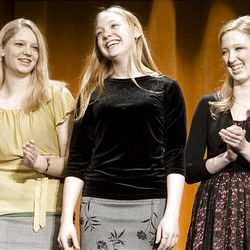 Rachelle Baker, the 2009 Sterling Scholar in dance, center, stands with runners-up Elizabeth Alley, left, and Kirsi Jarvis during the Sterling Scholar awards ceremony at Cottonwood High School on Wednesday night.