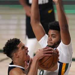 Denver Nuggets' Michael Porter Jr. (1) goes up for a shot as Utah Jazz's Juwan Morgan (16) defends during the first half an NBA first round playoff basketball game, Tuesday, Sept. 1, 2020, in Lake Buena Vista, Fla.