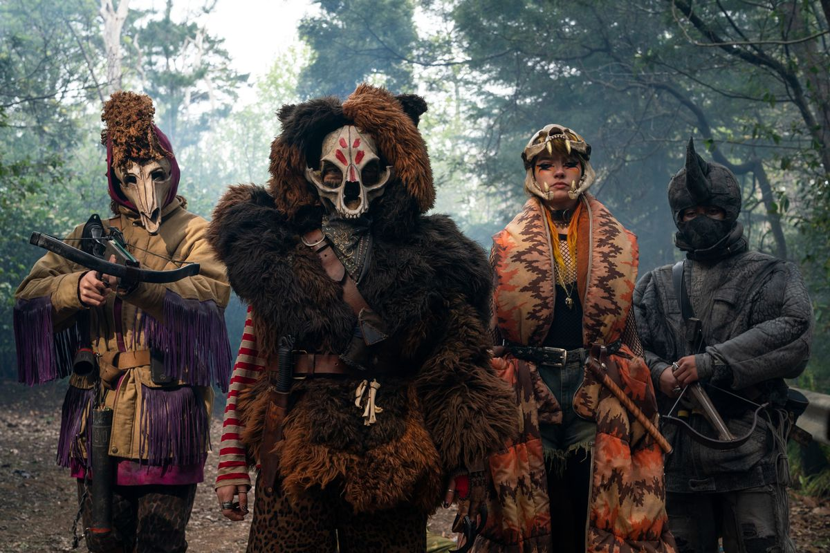 Sweet Tooth's Animal Army, four people dressed in elaborate animal costumes.