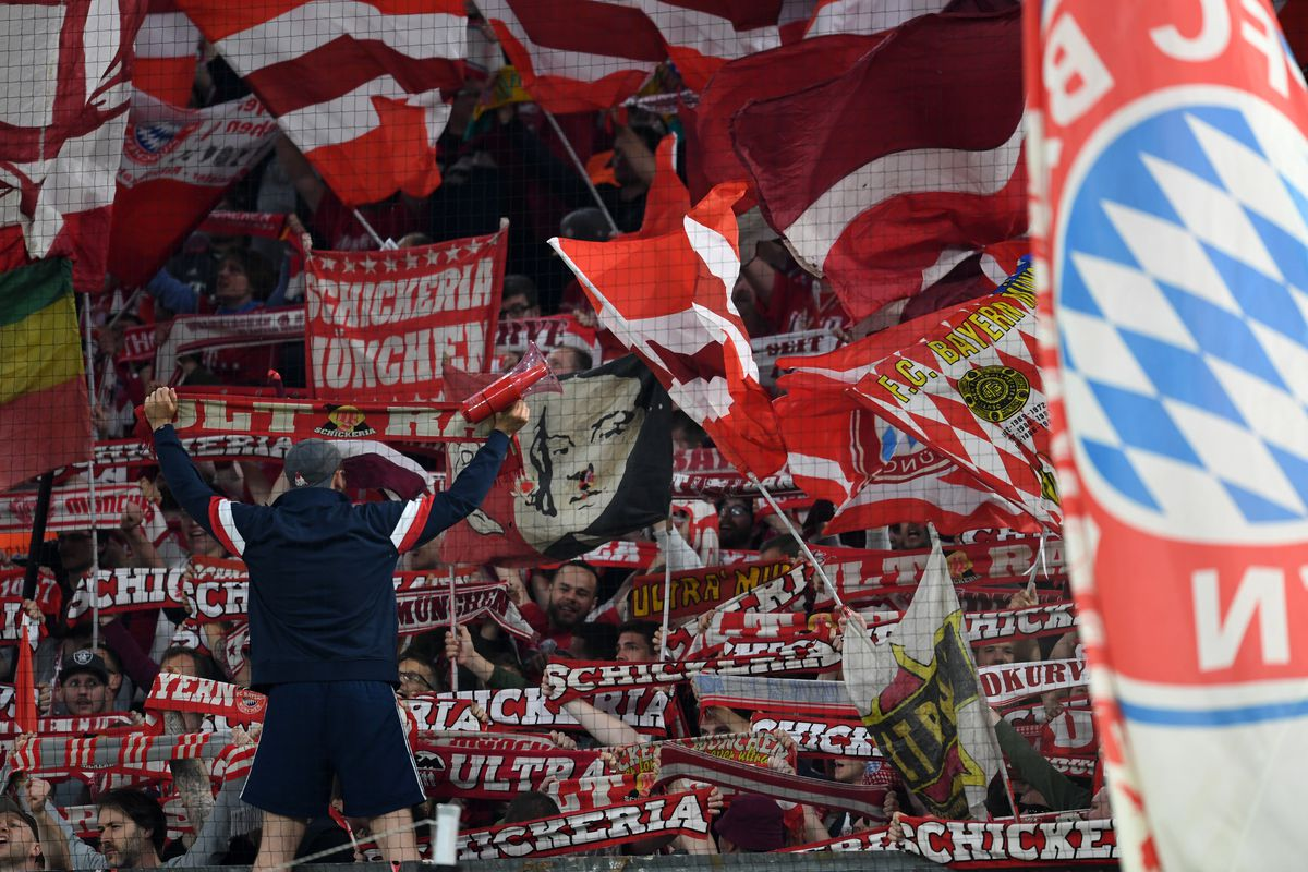 MUNICH, GERMANY - APRIL 25: Bayern Munich supporters cheer prior to the UEFA Champions League Semi Final First Leg match between Bayern Muenchen and Real Madrid at the Allianz Arena on April 25, 2018 in Munich, Germany.
