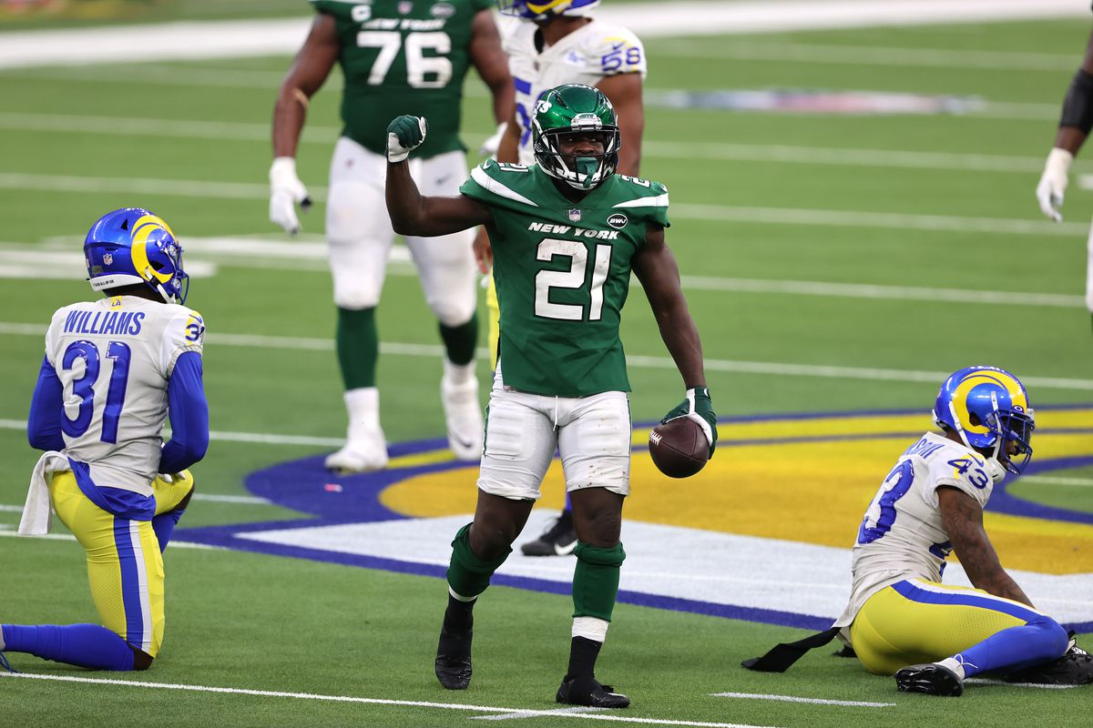 Darious Williams #31 and John Johnson #43 of the Los Angeles Rams look on as Frank Gore #21 of the New York Jets reacts to extra yards during the second half of a game at SoFi Stadium on December 20, 2020 in Inglewood, California.