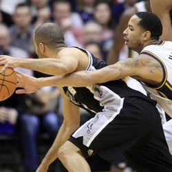 Utah Jazz guard Devin Harris (5) tries to knock the ball away from San Antonio Spurs guard Tony Parker (9) as the Utah Jazz and the San Antonio Spurs play Monday, Feb. 20, 2012 at Energy Solutions arena in Salt Lake City. Spurs won 106-102
