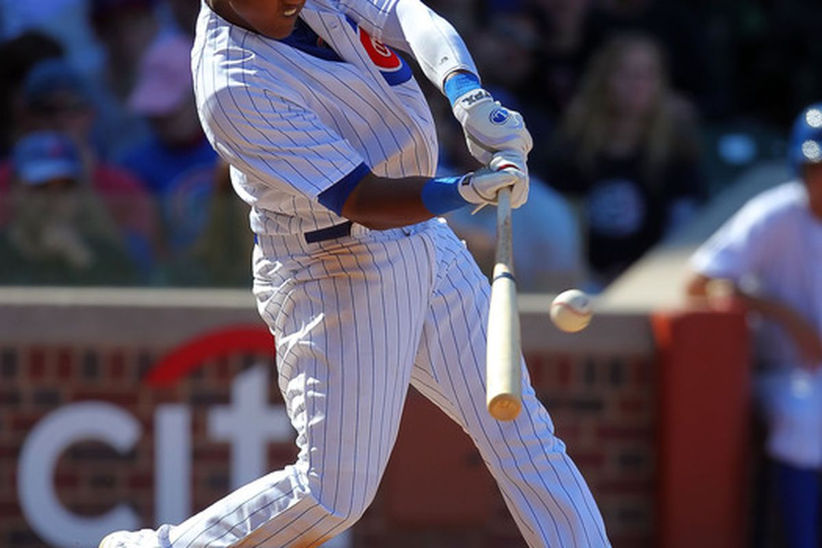 Chicago, IL, USA; Chicago Cubs shortstop Starlin Castro hits a double during the eighth inning against the Washington The Cubs won 4-3. Nationals at Wrigley Field. Credit: Dennis Wierzbicki-US PRESSWIRE