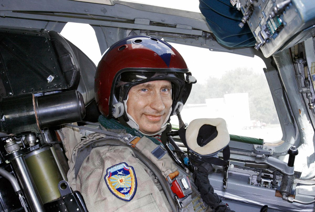 Russian President Vladimir Putin poses for a picture inside a plane that can carry cruise missiles on August 16, 2005.