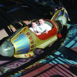 Current BYU offensive linemen  Connor Pay, front, James Empey share a ride at Disneyland during they youth.