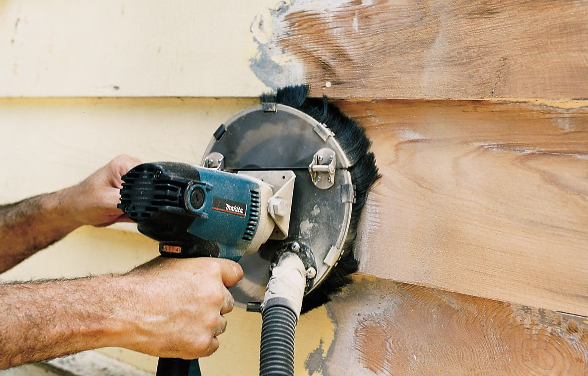 Man Grinds Off Old House Paint Using Power Sanding Disk