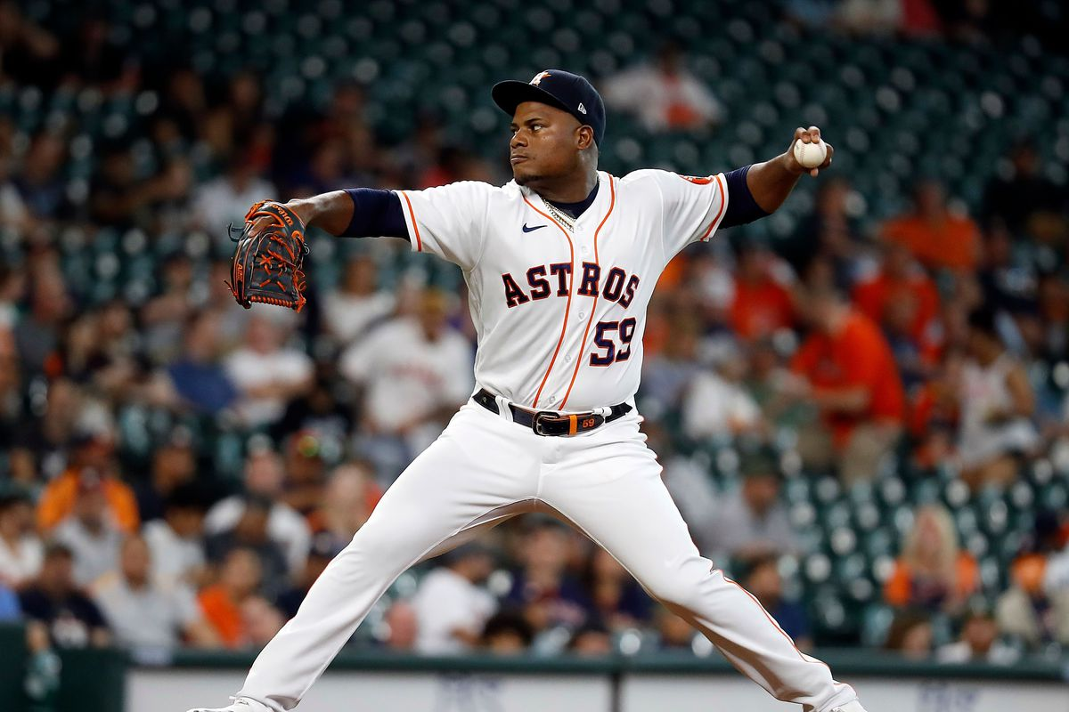 Framber Valdez #59 of the Houston Astros pitches in the first inning against the Oakland Athletics at Minute Maid Park on July 06, 2021 in Houston, Texas.