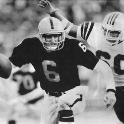 BYU Quarterbacks online photo gallery: Raiders quarterback Marc Wilson narrowly escapes the grasp of New England Patriots defensive end Garin Veris during the second quarter of the AFC playoffs in Los Angeles on Jan. 5, 1986.