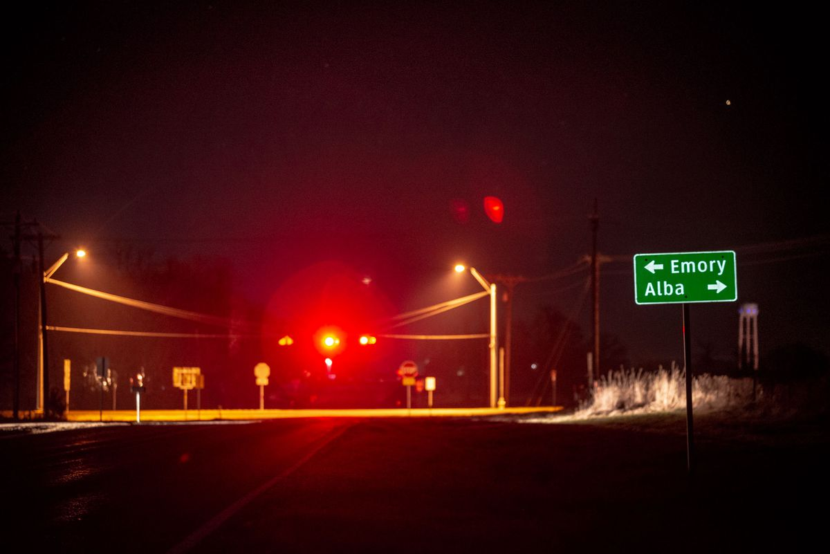 A road sign on Farm-to-Market Road 779 in Rains County, Texas, points to Emory, where the sheriff's office is located, and Alba, where Palos Park obstetrician and gynecologist Dr. George Chronis was found dead on his remote property in May 2018.