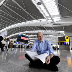 Author Alain de Botton sits in London Heathrow Airport's Terminal 5.  The philosophy writer has become the airport's first writer-in-residence.