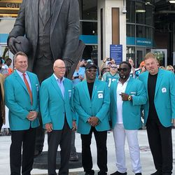 Jason Taylor, John Offerdal, Dick Anderson, Mark Clayton, Mark Duper, and John Giesler after the Miami Dolphins Walk of Fame induction ceremony on December 2, 2018 in the Joe Robbie Alumni Plaza at Hard Rock Stadium, Miami Gardens, Florida.