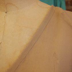 Raw edge neck detail