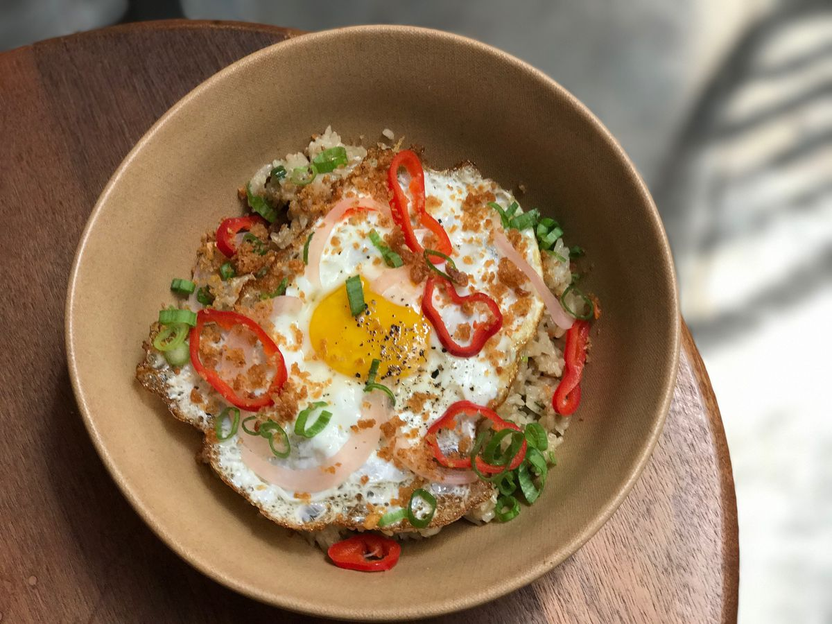 Sunny eggs in a bowl with rice.