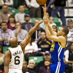 Warriors guard Stephen Curry (30) shoots over Jazz guard Jamaal Tinsley (6) during the first half of the NBA basketball game between the Utah Jazz and the Golden State Warriors at Energy Solutions Arena, Wednesday, Dec. 26, 2012.