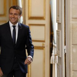 French President Emmanuel Macron arrives for a press conference with Senegal's President Macky Sall at the Elysee Palace in Paris, France, Monday, June 12, 2017.
