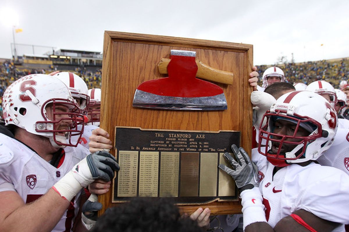 """BERKELEY CA - NOVEMBER 20:  The Stanford Cardinal celebrate with """"The Axe"""" after beating the California Golden Bears at California Memorial Stadium on November 20 2010 in Berkeley California.  (Photo by Ezra Shaw/Getty Images)"""
