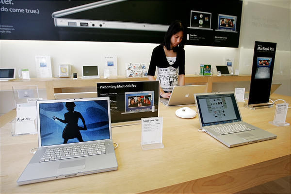 A customer checks out an Apple MacBook Pro on display in San Francisco.