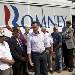 """Republican presidential candidate, former Massachusetts Gov. Mitt Romney speaks with the news media after making a stop at the """"New Hampshire Veterans and Military Families for Mitt"""" event, Thursday, Sept. 6, 2012, in Concord, N.H."""