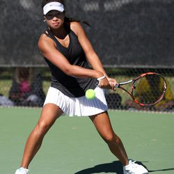 Lone Peak's Leah Heimuli competes in the first singles 5A girls high school tennis championships at Liberty Park in Salt Lake City on Saturday, Oct. 10, 2015.