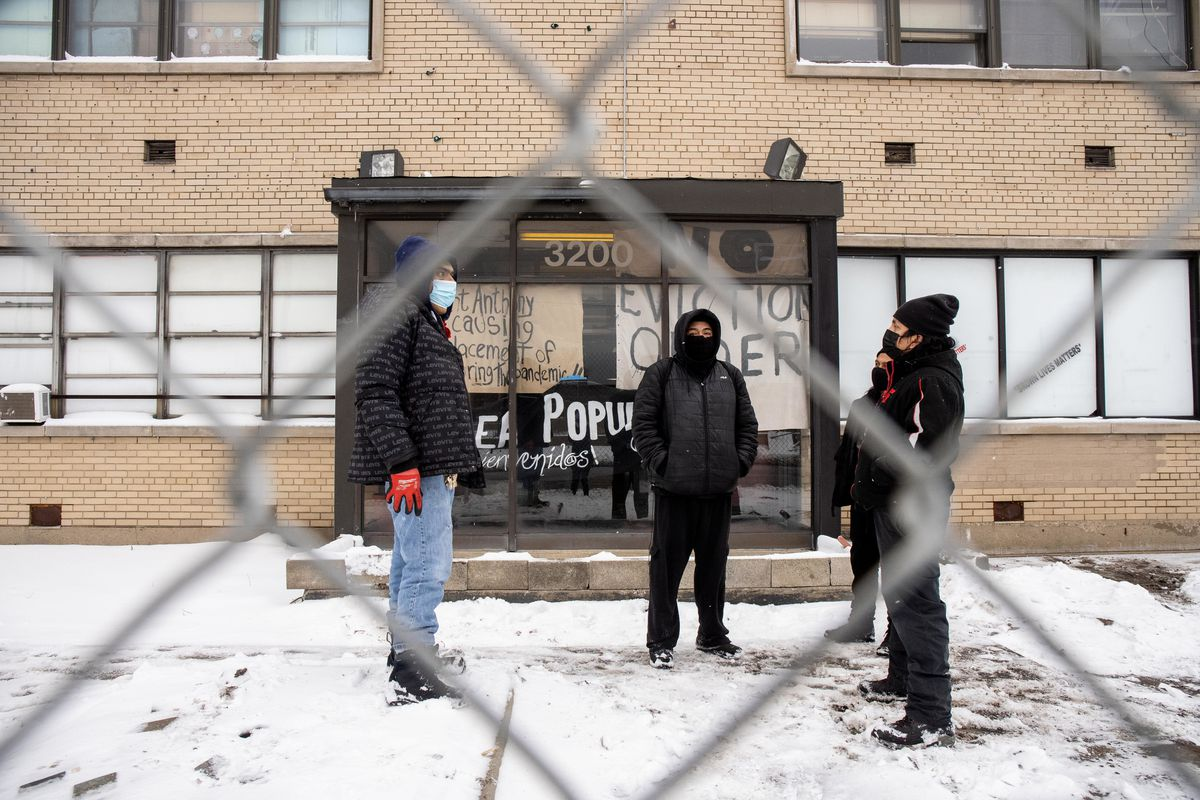 Juan Herrera, Agustin Aguilar, Ivan Cruz and Marcos Hernandez stand outside their apartment at 3200 S. Kedzie Ave. in the Little Village neighborhood,