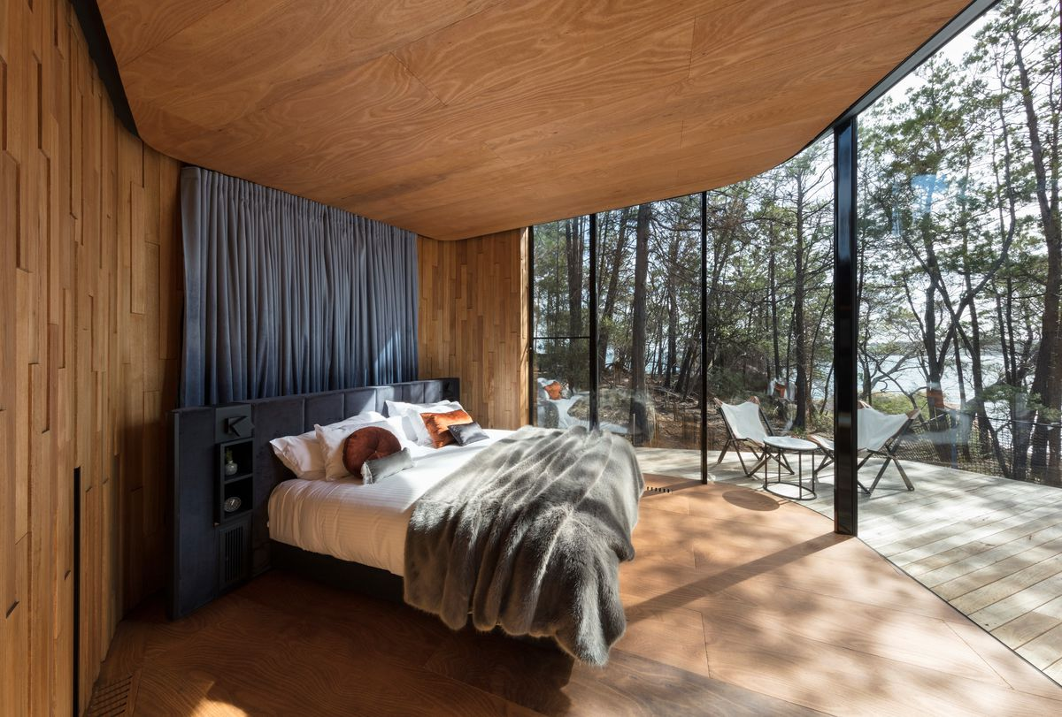 Bedroom with windows looking out onto deck