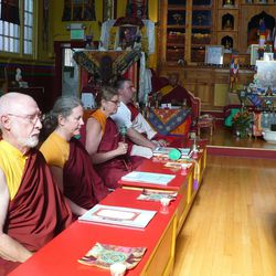 Gary Stephenson, left, Leslie Smith, Kay Barikman and Mark Yakovich joing Lama Thupten Dorje Gyaltsen in chanting mantra of compassion at Prayers for Compassion event at Salt Lake City's Tibetan Buddhist Temple.