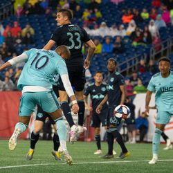 FOXBOROUGH, MA - APRIL 20: New England Revolution forward Teal Bunbury #10 heads a Diego Fagundez cross towards goal during the second half at Gillette Stadium on April 20, 2019 in Foxborough, Massachusetts. (Photo by J. Alexander Dolan - The Bent Musket)