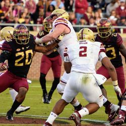 FR LB Jaiden Woodbey only needs one arm to shove off an olineman.