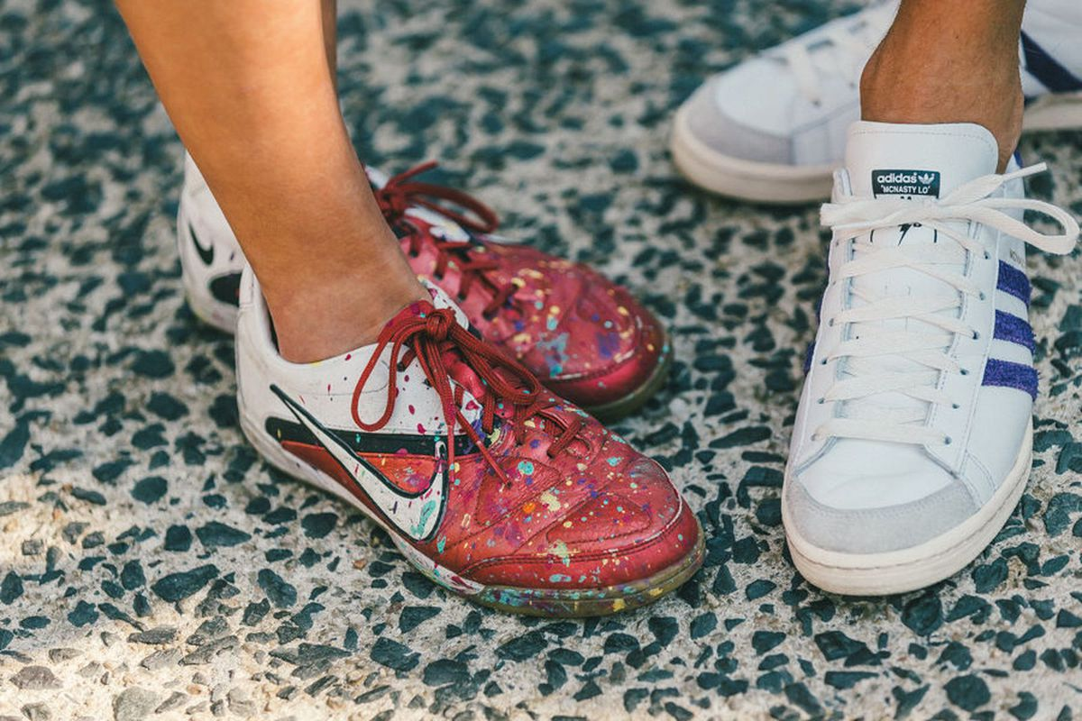 Close-ups of red-and-white paint-splattered Nike sneakers and blue-and-white Adidas sneakers.