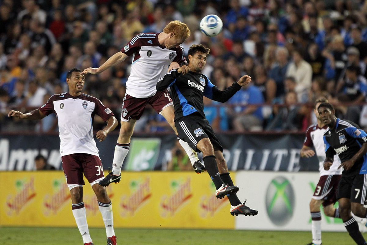 SANTA CLARA, CA - AUGUST 13:  Chris Wondolowski #8 of the San Jose Earthquakes and Jeff Larentowicz #4 of the Colorado Rapids go for the ball at Buck Shaw Stadium on August 13, 2011 in Santa Clara, California.  (Photo by Ezra Shaw/Getty Images)