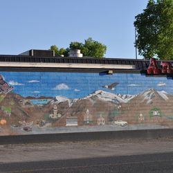 A mural is painted on the side of Angie's Restaurant.