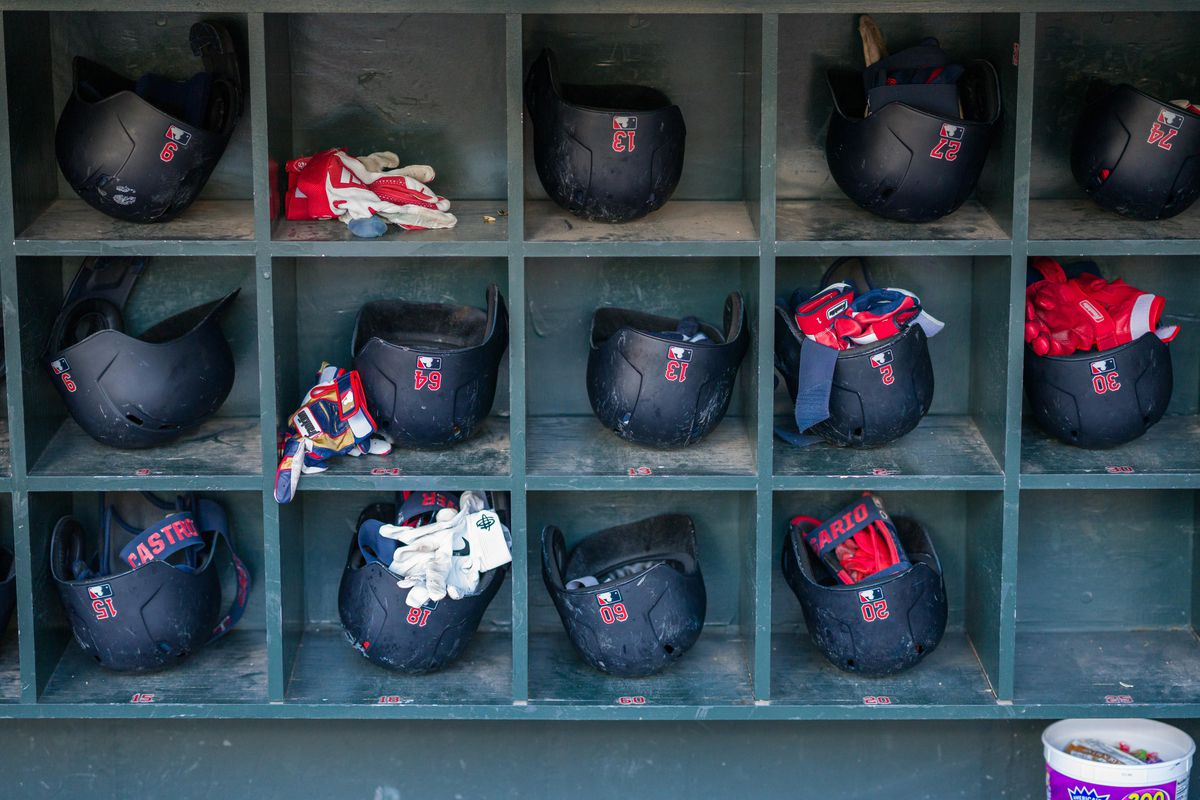 A general view of the Minnesota Twins helmets in the dugout during pre game batting practice before the game against the Kansas City Royals at Target Field.