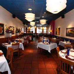 The 20-plus-year-old Topolobampo has a rich design that complements Rick Bayless' stunning and groundbreaking Mexican fare. Awash in gorgeous tile, modern lighting and Mexican art, the room competes for attention with the cuisine.