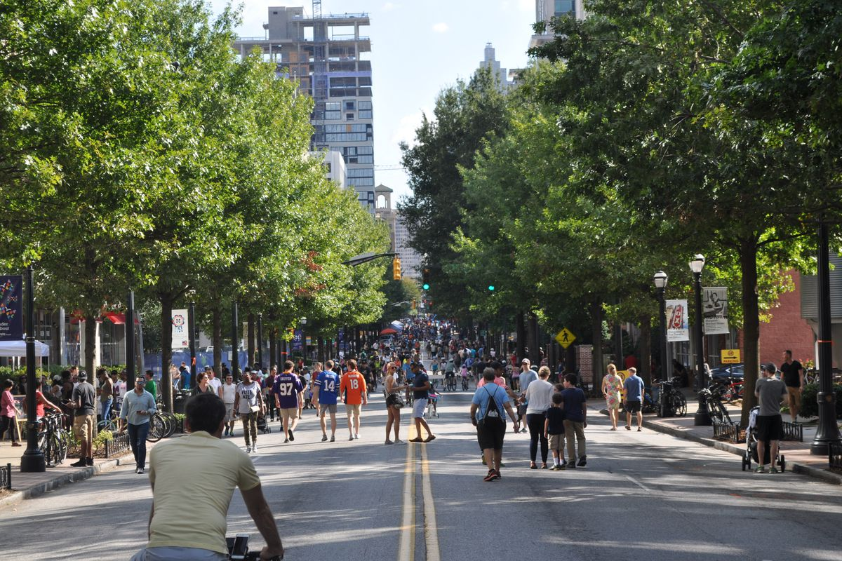 A view down Peachtree Street, with hundreds of cyclist and pedestrians packing the street.