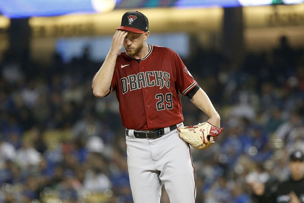 Merrill Kelly scratches underneath his hat after giving up a home run, accurately representing how most Diamondbacks fans feel at this point